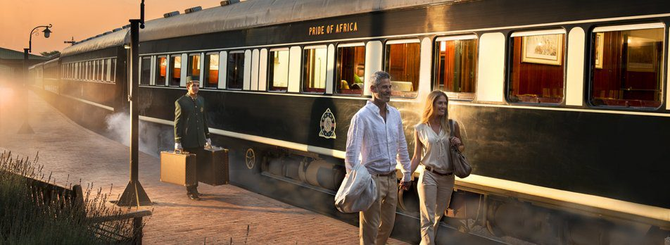 two people outside luxury rovos rail on this Africa train safari