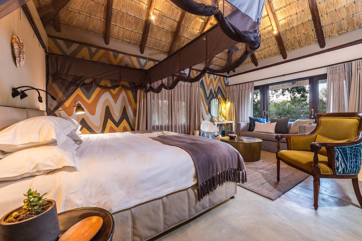 colorfully painted wall and interiors of a sabi sabi little bush camp suite on this Southern Africa safari