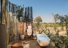 outdoor bathtub and shower in the bush at sable alley