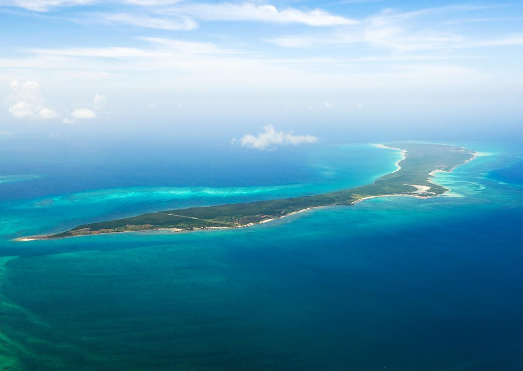aerial view of an island in turquoise water