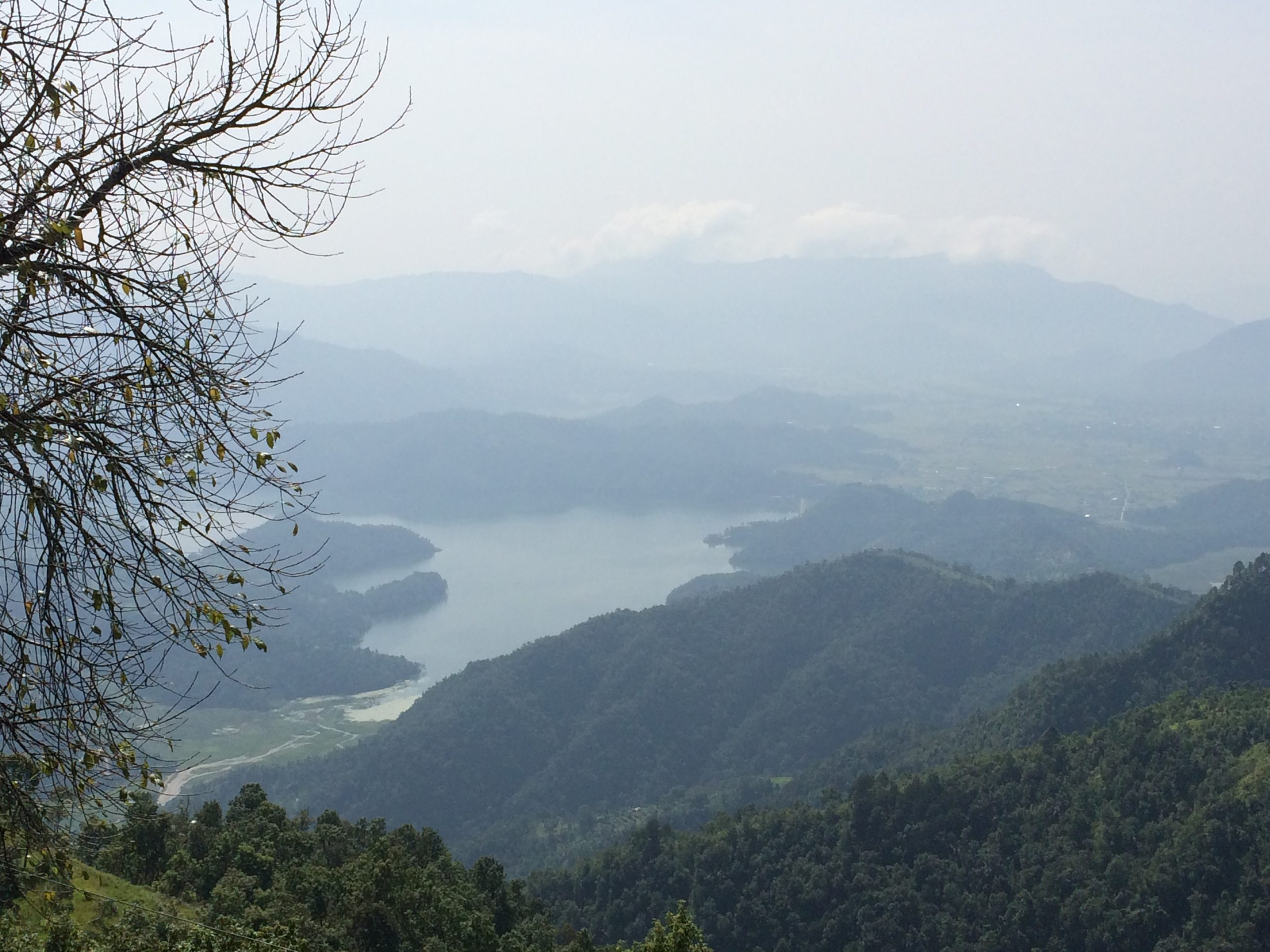 Phewa Lake from atop a hill with mountains in the distance, Pokhara Nepal