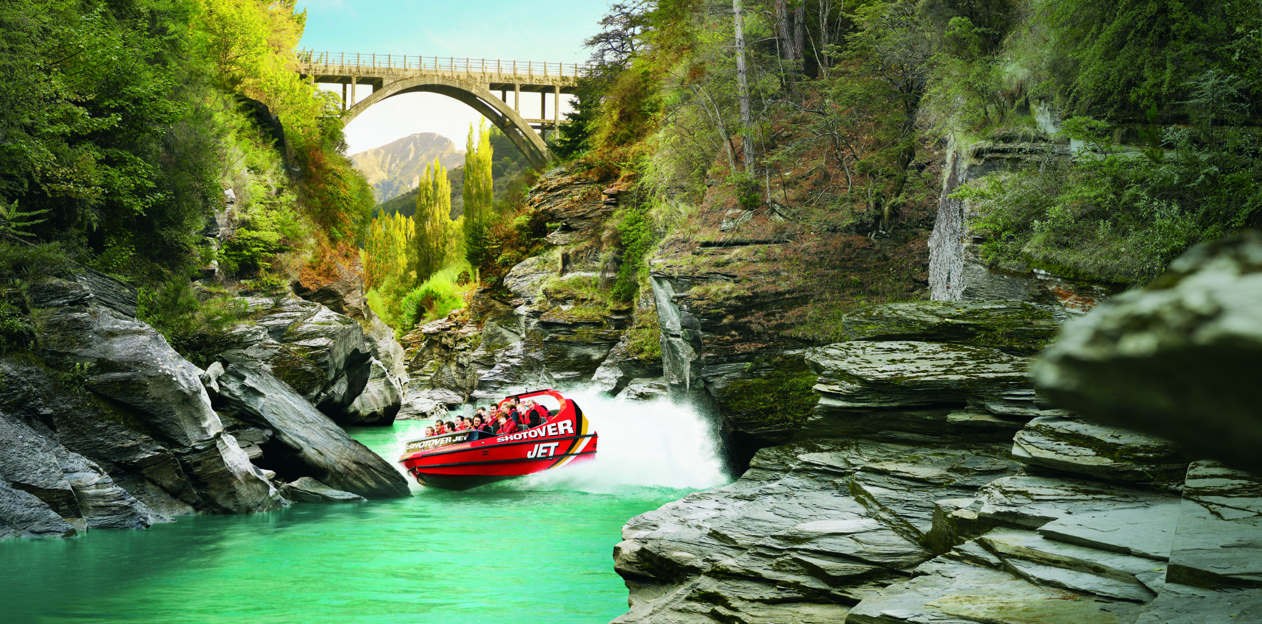 Shotover Jet boat speeds through a tight crevasse.