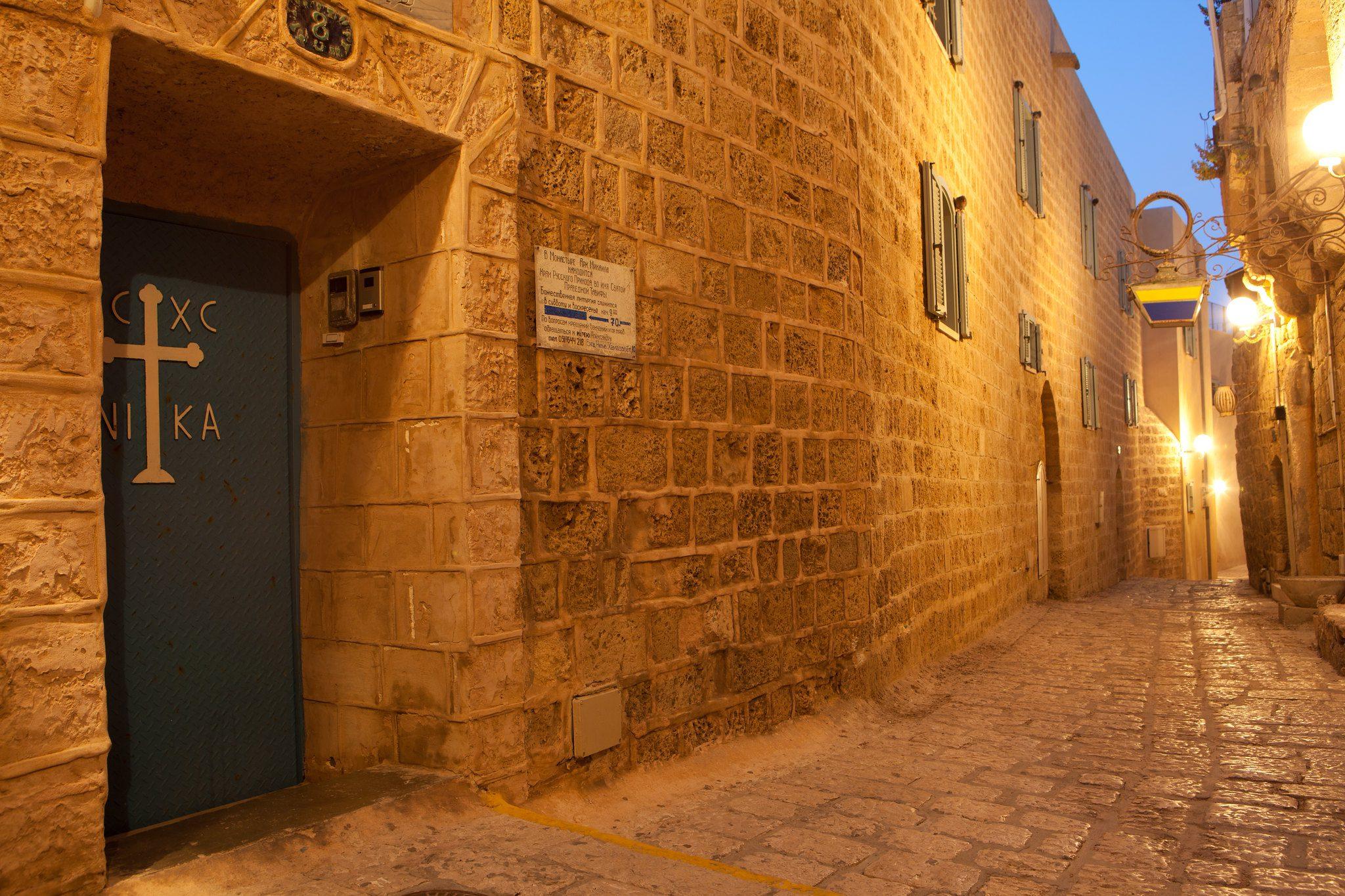 Ancient cobblestone street at sunset in Jaffa