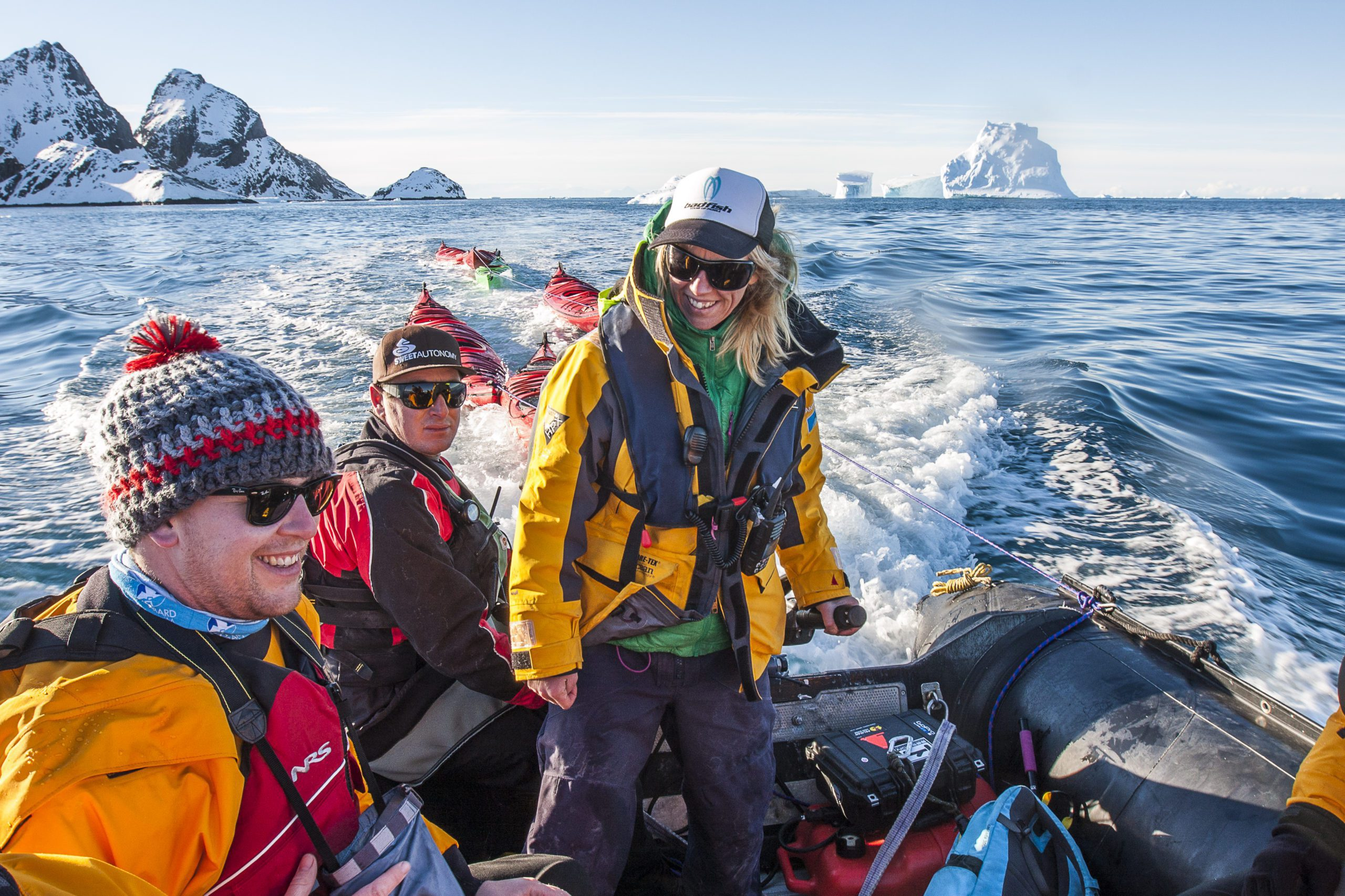 smiling guests on a zodiac cruise in Antarctica