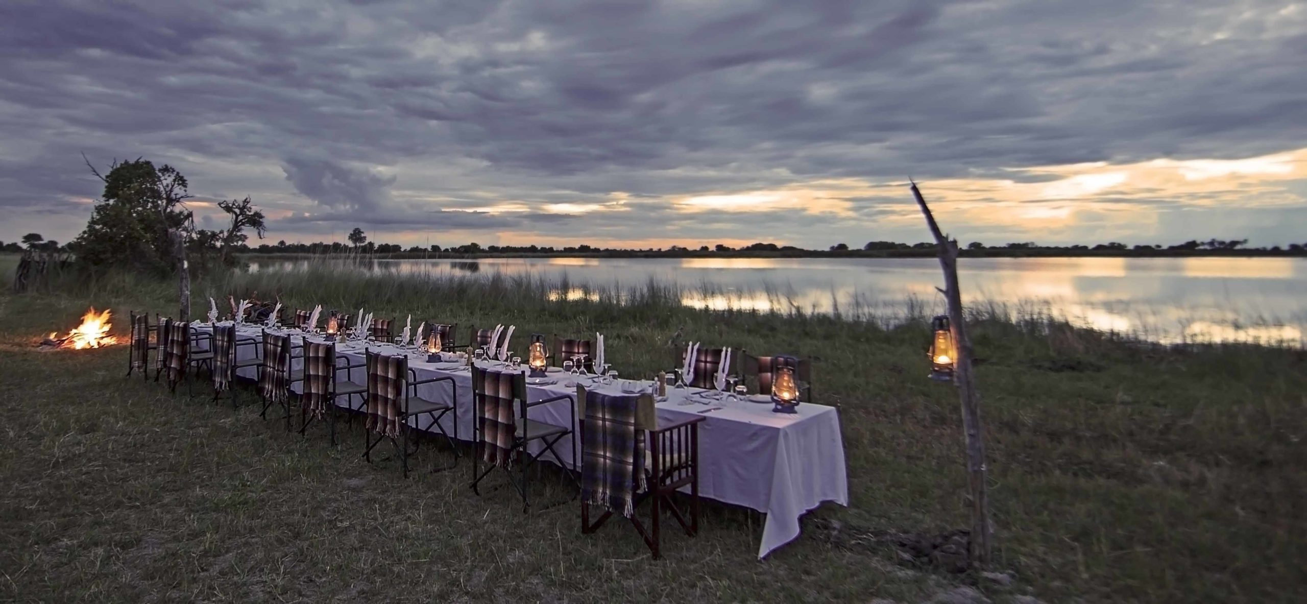 shinde camp bush dinner by the water seen on our Botswana safari