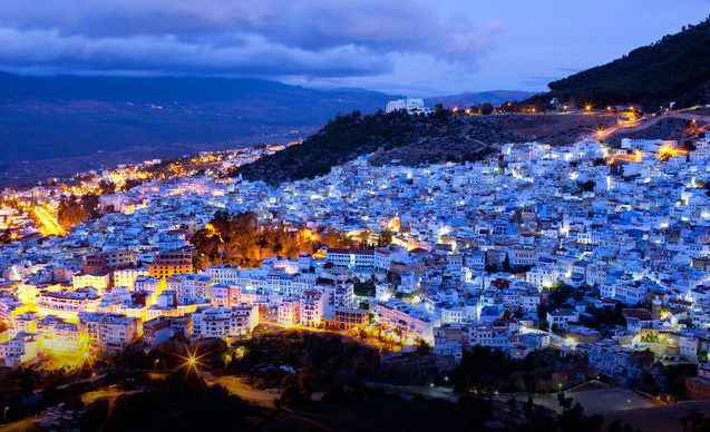 Mountainous blue city of Chefchaouen alit during sunset