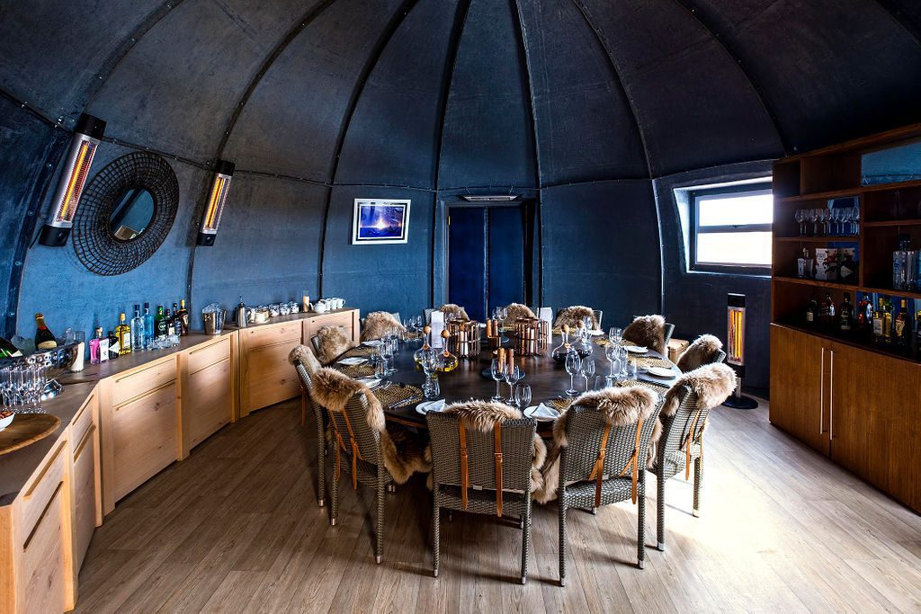 round table and chairs in the cozy dining pod at Whichaway Camp in Antarctica