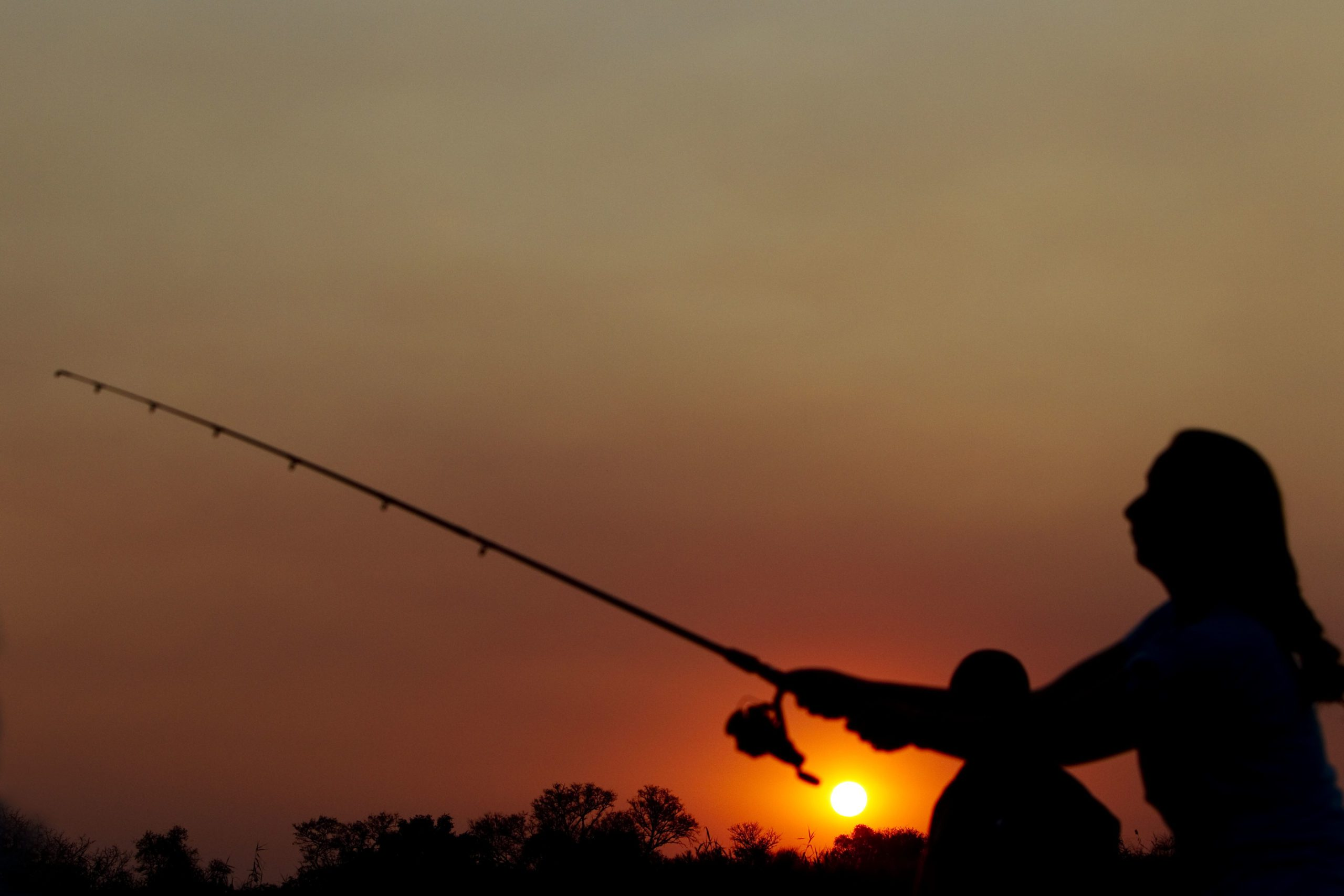 While on our Botswana safari try your hand at Okavango Delta fishing at sunrise