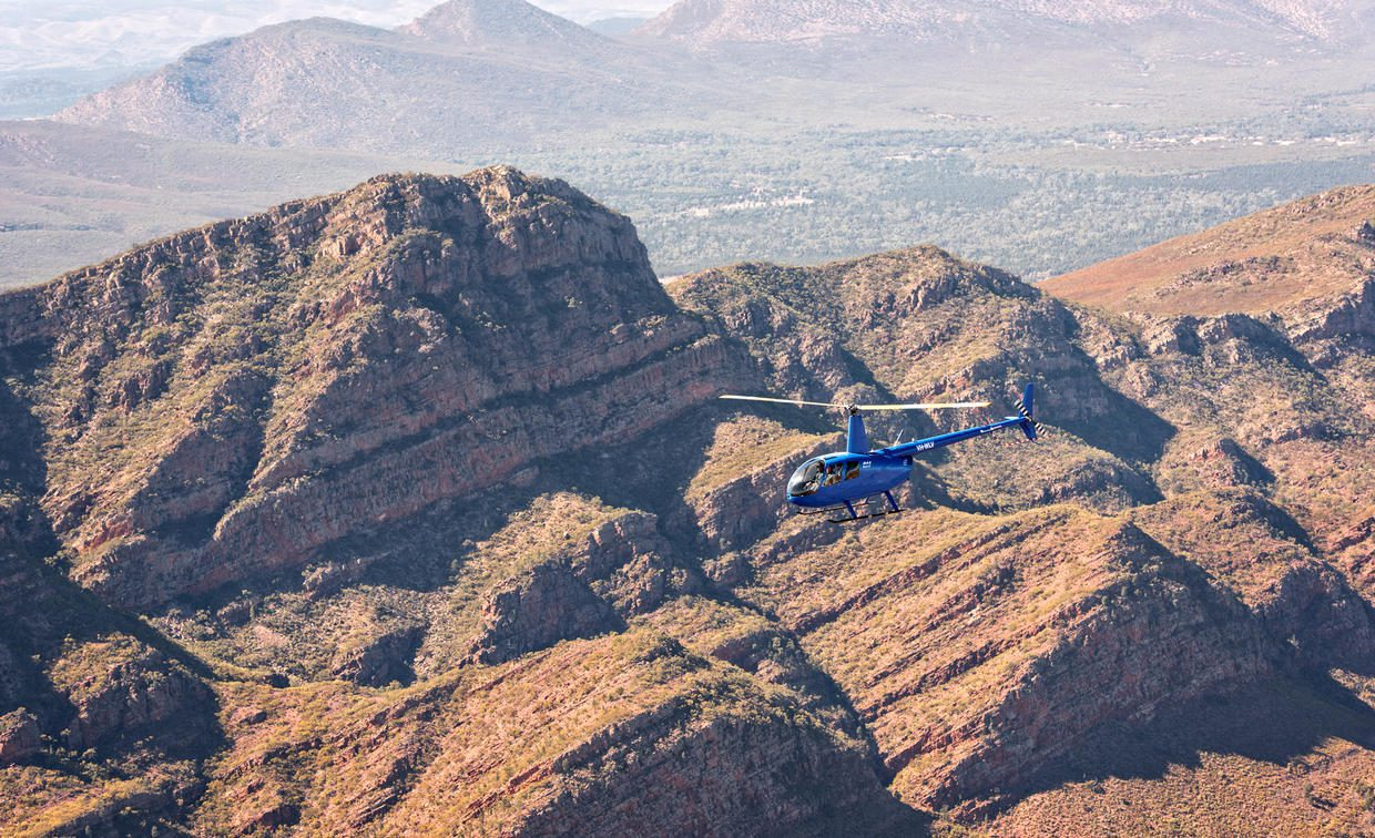 A helicopter safari over the red rocks of the Wilpena Pound in South Australia.