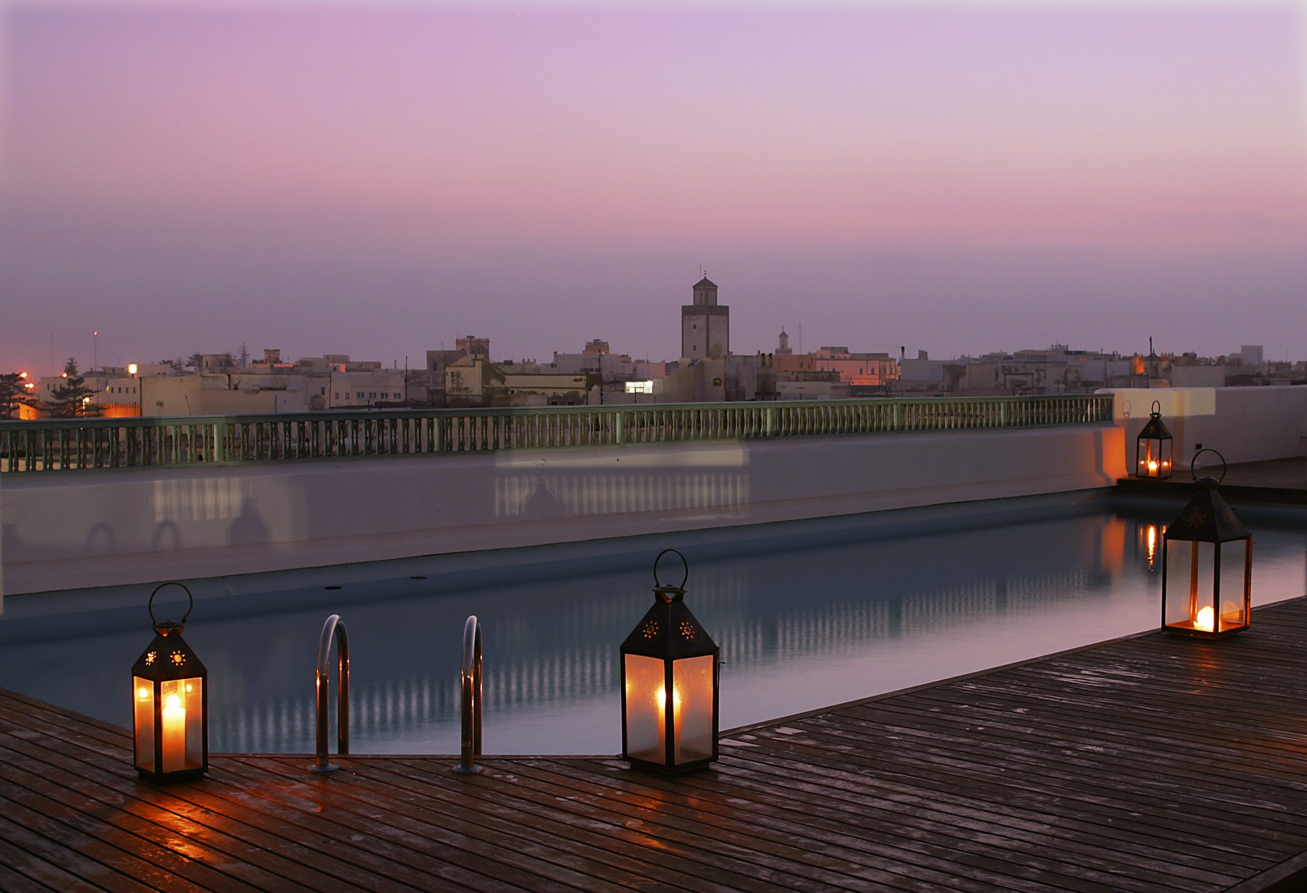 Rooftop pool at sunset at Heure Bleue Palais