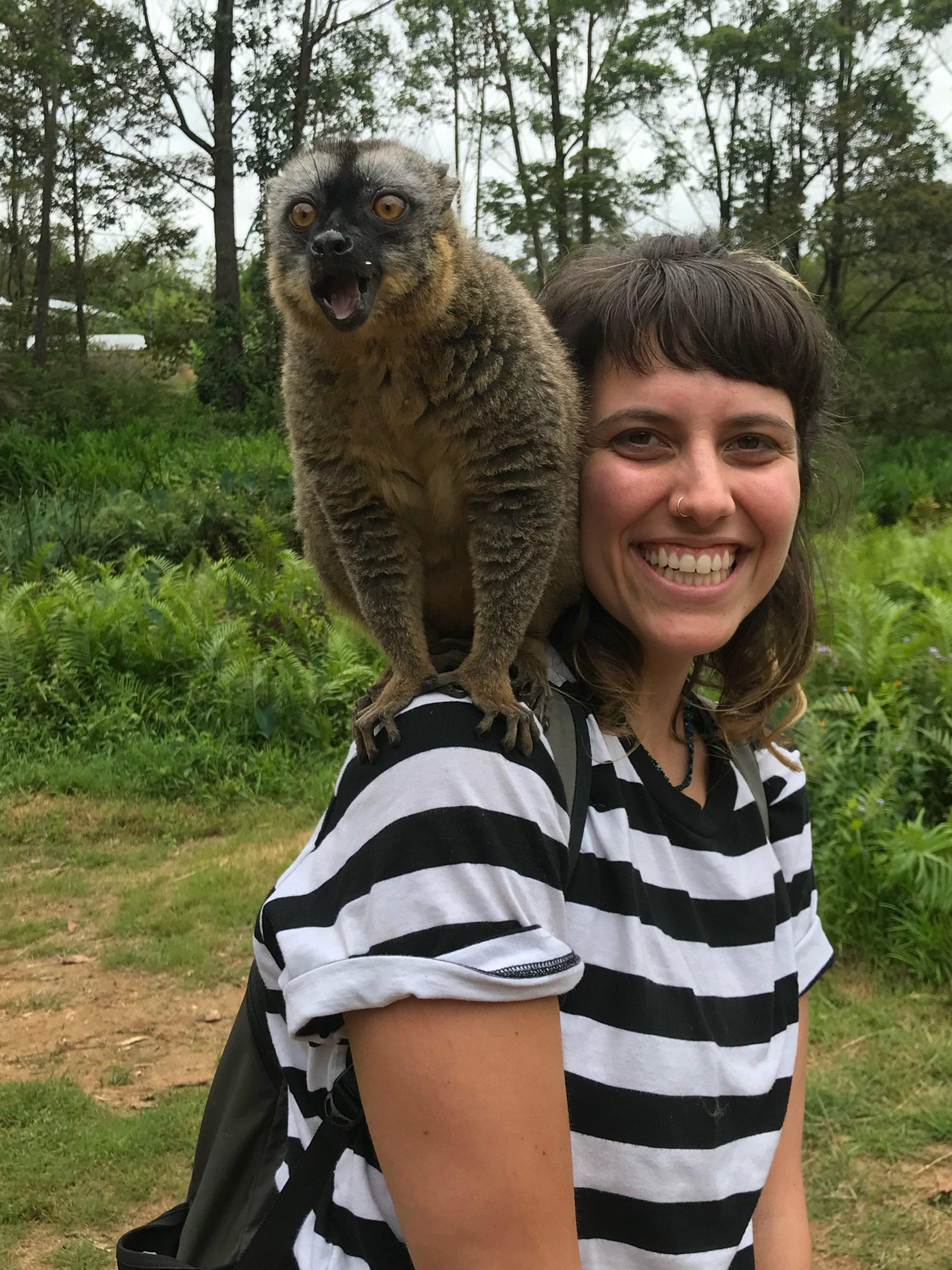 Dania with Lemur on shoulder on Lemur Island