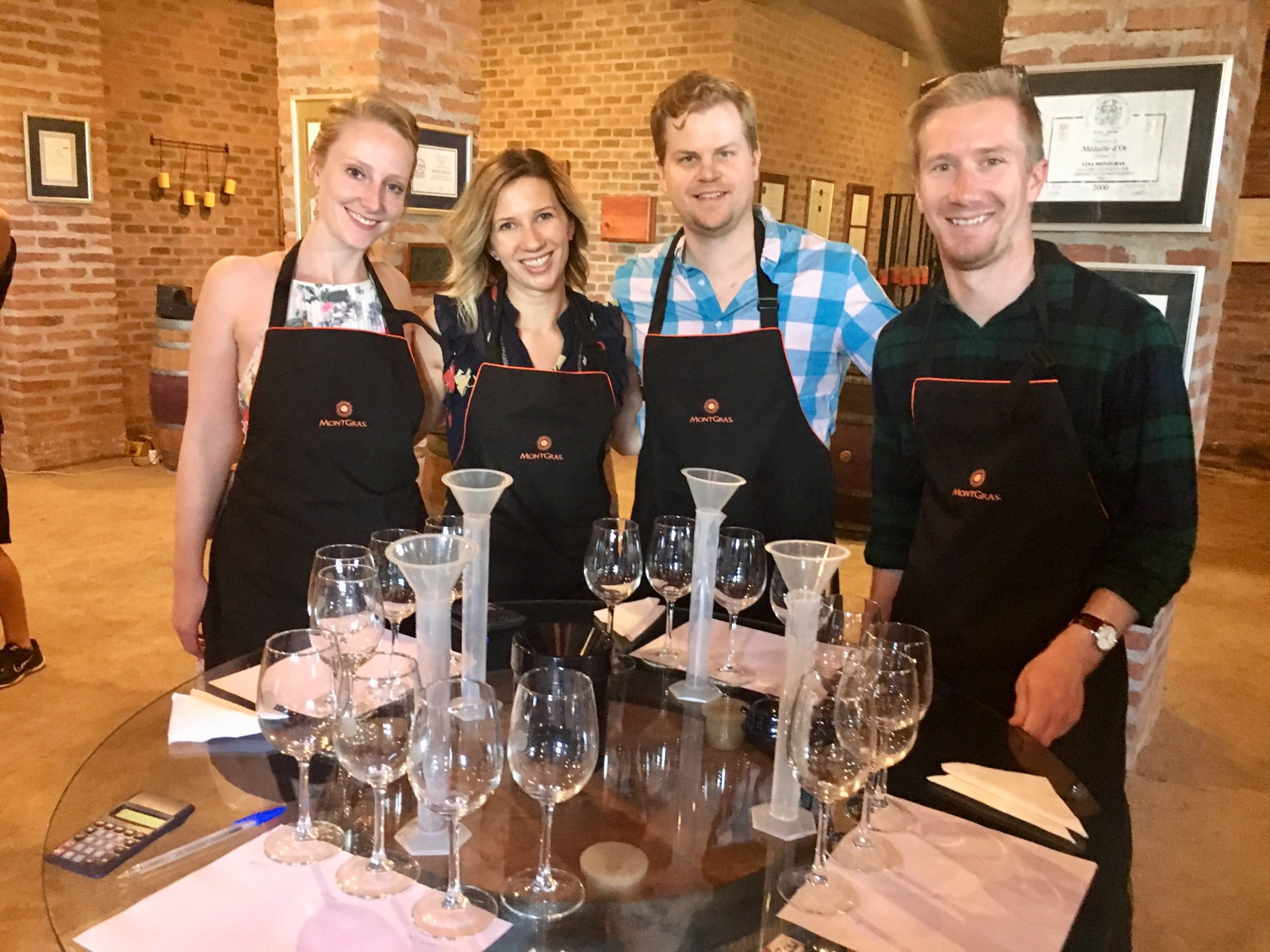 four people enjoying mixing their own wines