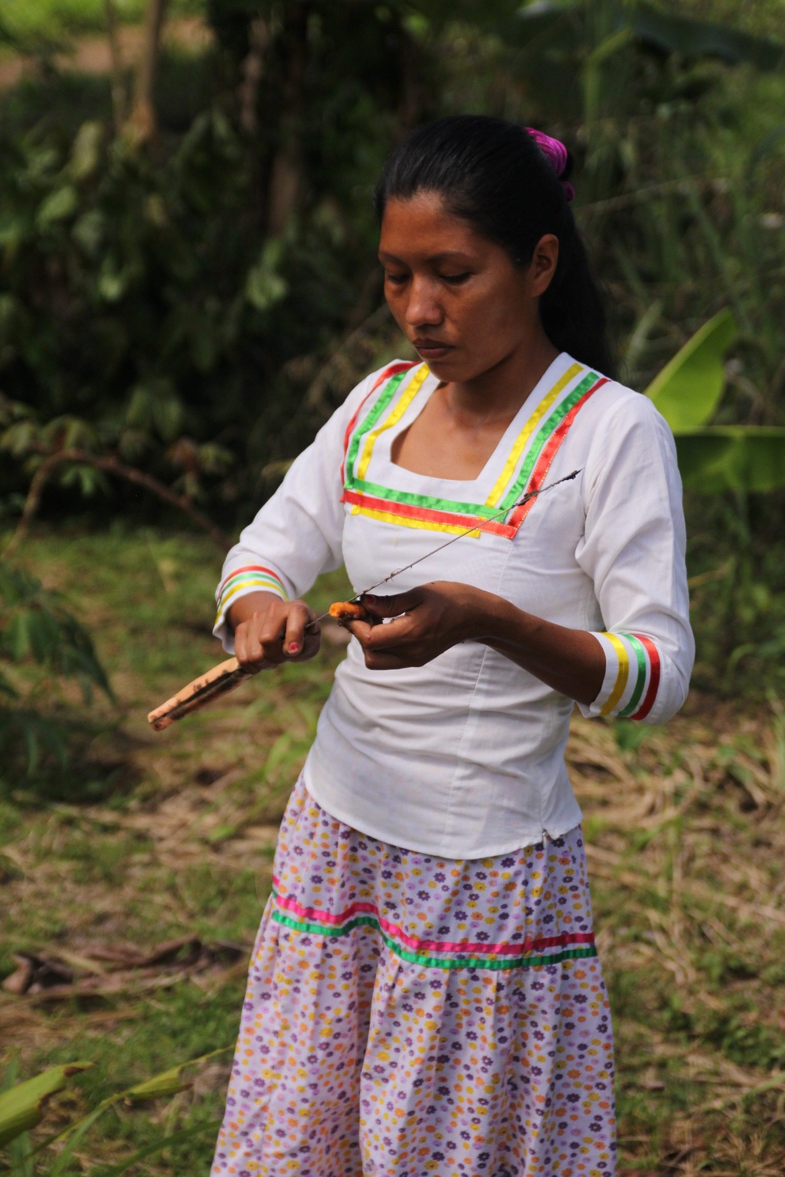 Tribal woman carving with knife in Ecuador Amazon