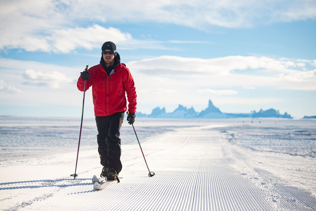 cross country skier in a red jacket enjoying an outing in Antarctica