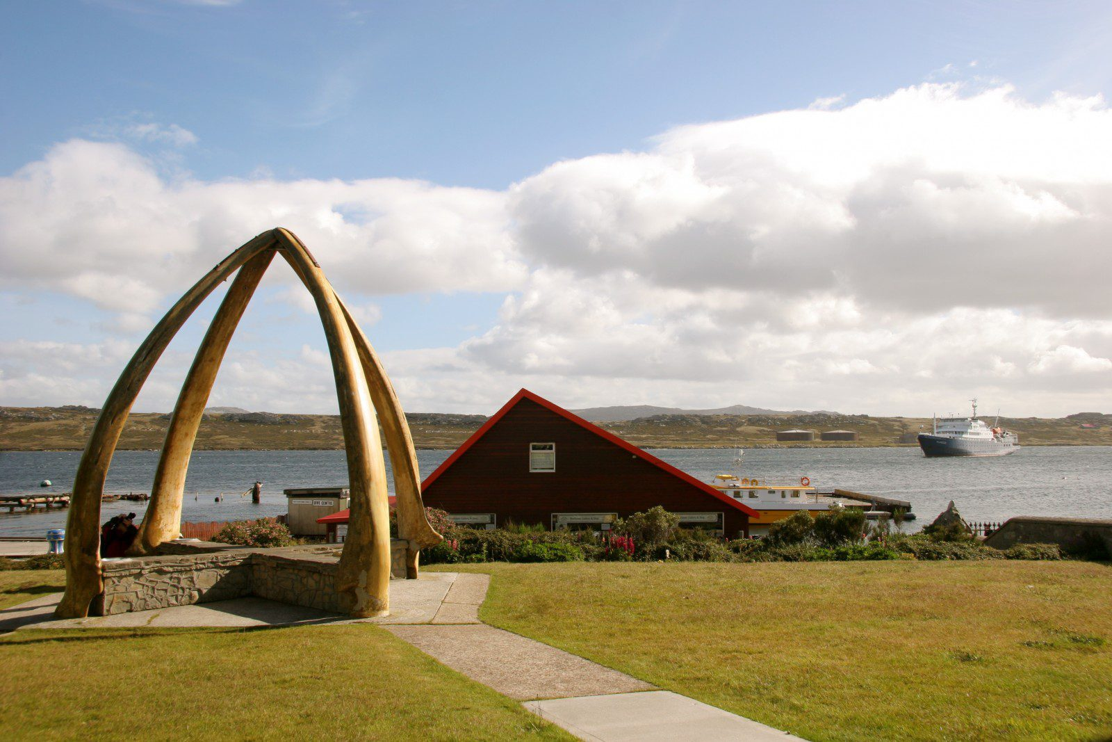 Whalebone Arch at the edge of the waters in Port Stanley on the Falkland Islands