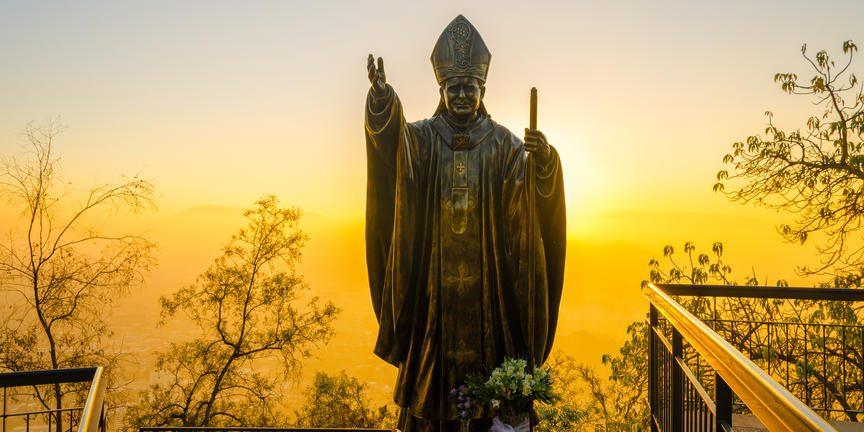 Sunset over statue in santiago