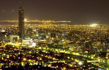 Santiago night sky lit up by colorful lights on this remarkable Chile trip