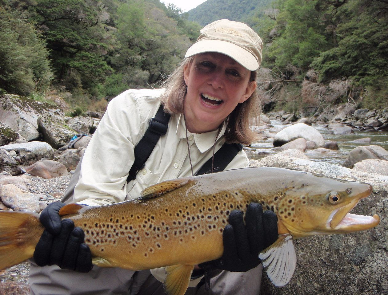 woman posing with a large fish caught at Stonefly Lodge