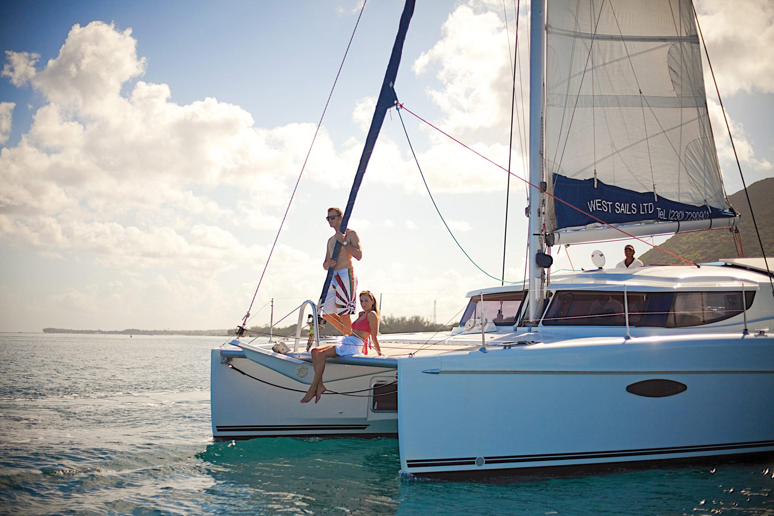 people on catamaran sailing