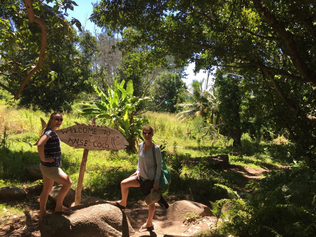 two people hike to Anse Source d'Argent
