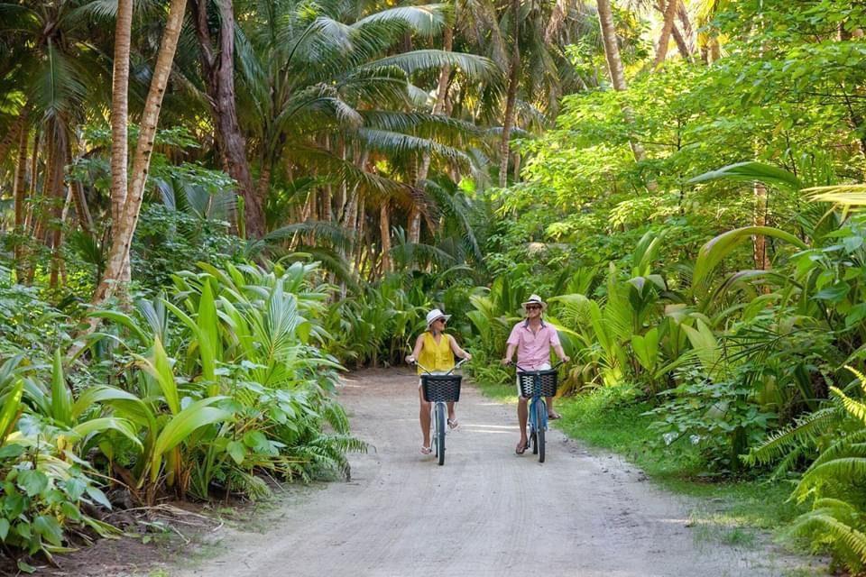 two people biking on jungle island on Seychelles safari