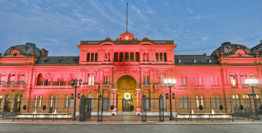 pink palace in BA lit up at night