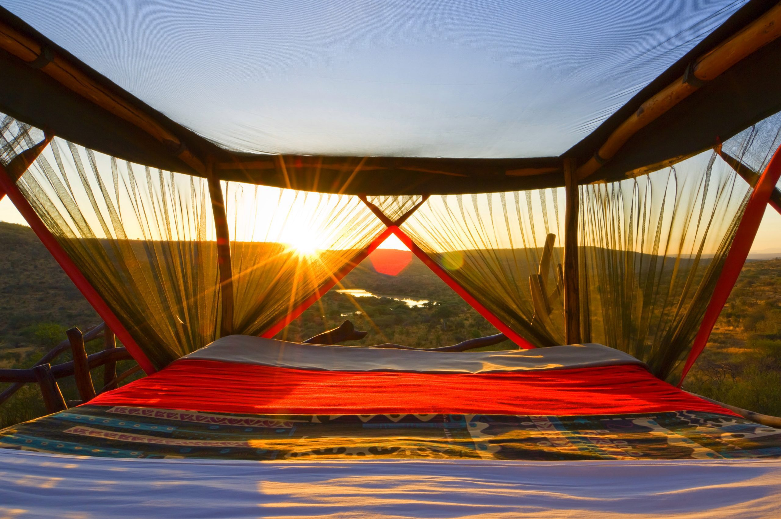 loisaba starbeds view from bed with sun setting on the best kenya safari