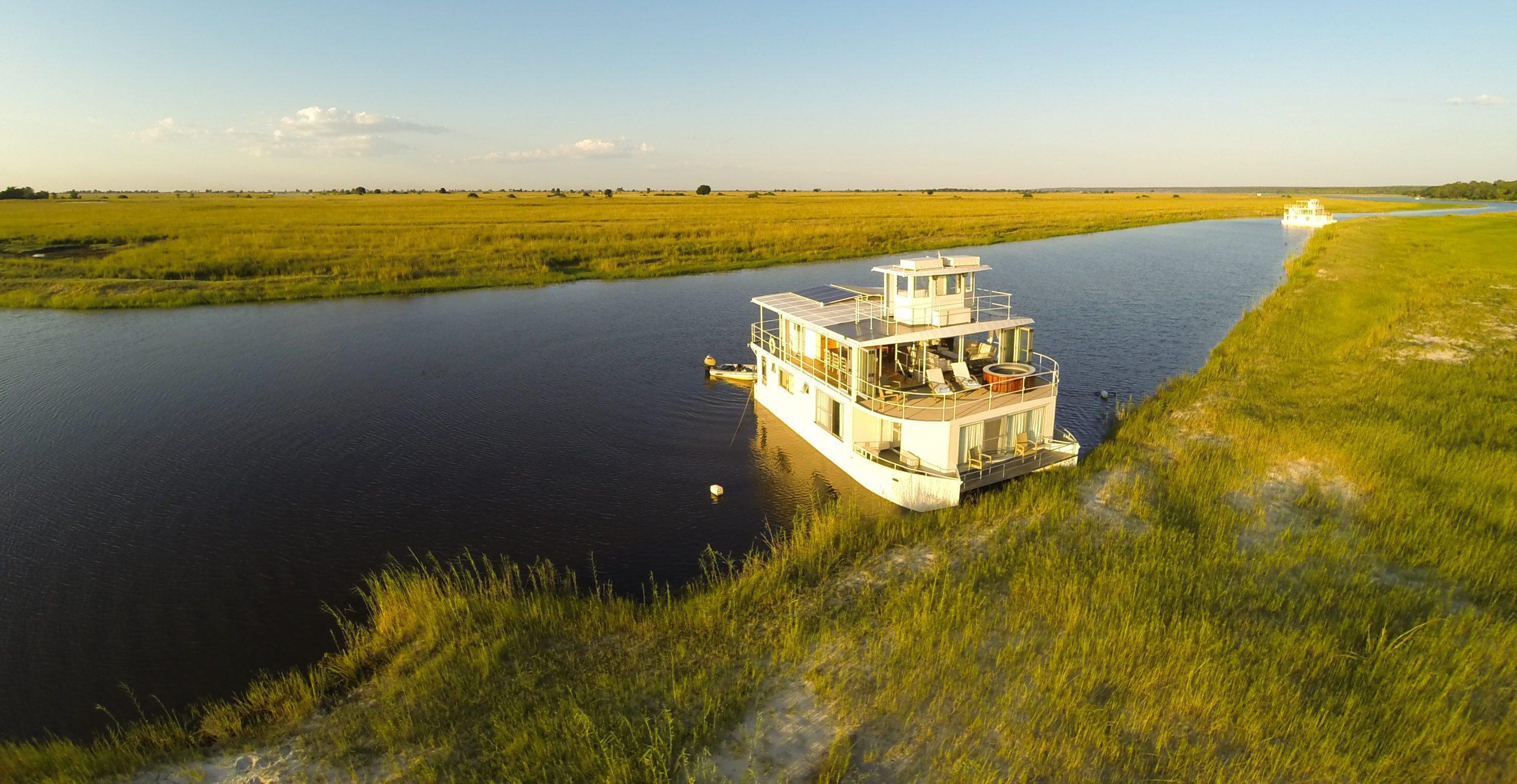 Chobe Princess river cruise stopped along the grassy banks