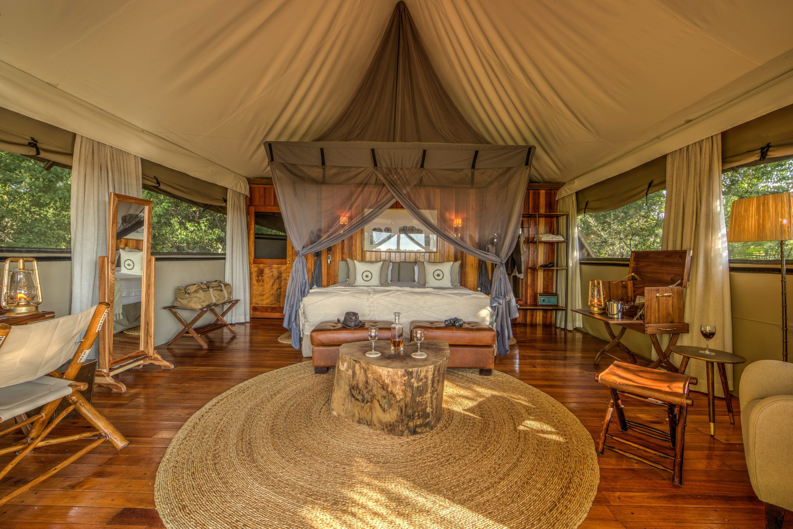 Kanana Camp interior room view of the bed and open air sides seen on our Botswana safari