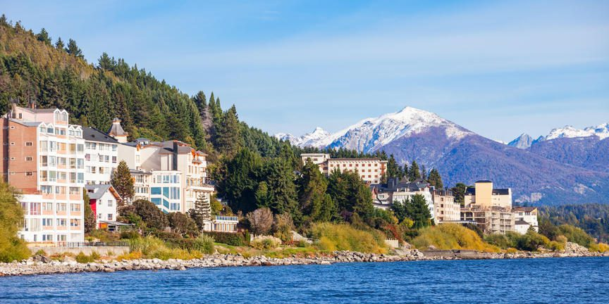 Mountain town with snow capped mountains behind a colorful array of hotels