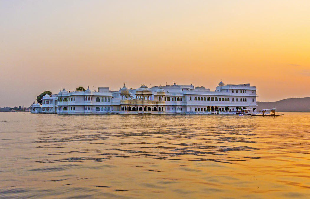 palace in the middle of Lake Pichola at sunset