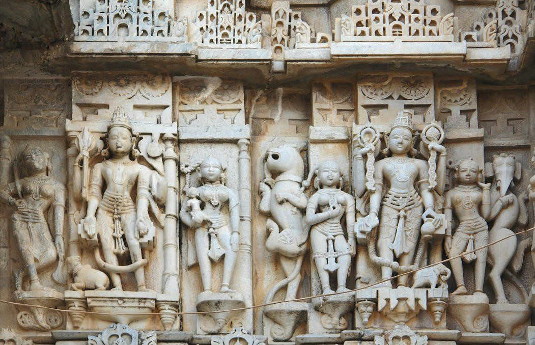 intricately carved marble figures on a temple in Udaipur