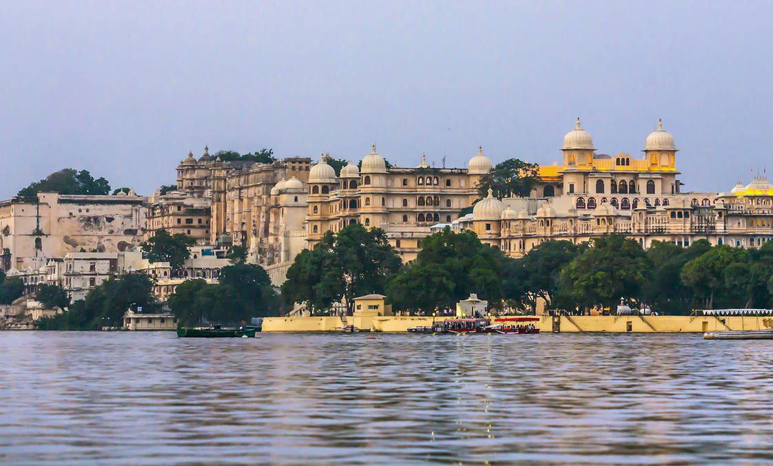 palace in Udaipur seen from Lake Pichola