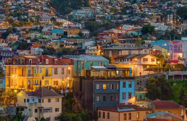 Valparaiso by night with colorful buildings and hills full of houses