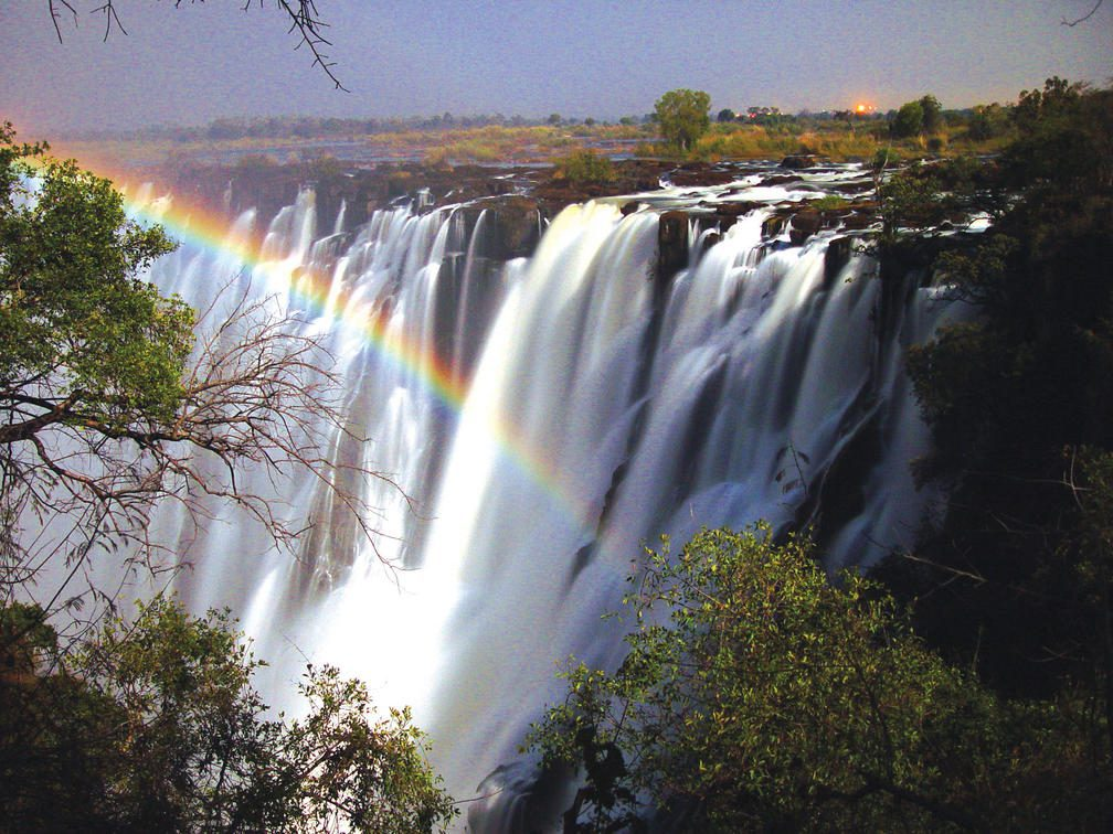rainbow over cascading victoria falls on Zambia & Zimbabwe luxury safari