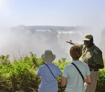 guide points to falls for two guests
