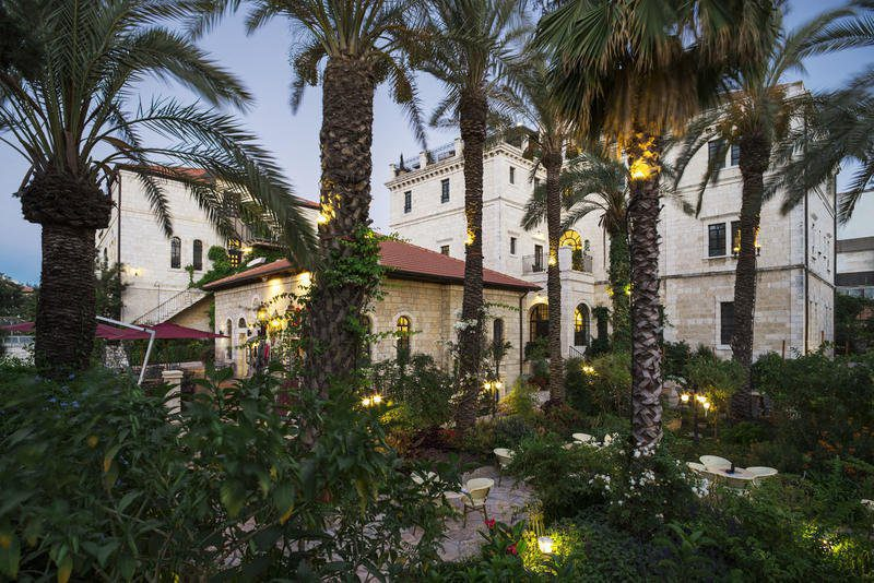 hotel gardens featuring palm trees and lights on this Israel holiday