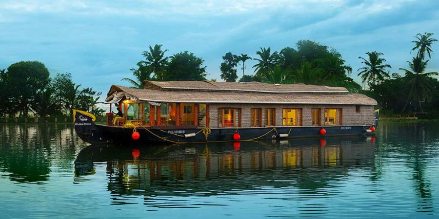 traditional houseboat floating the channels and palm trees