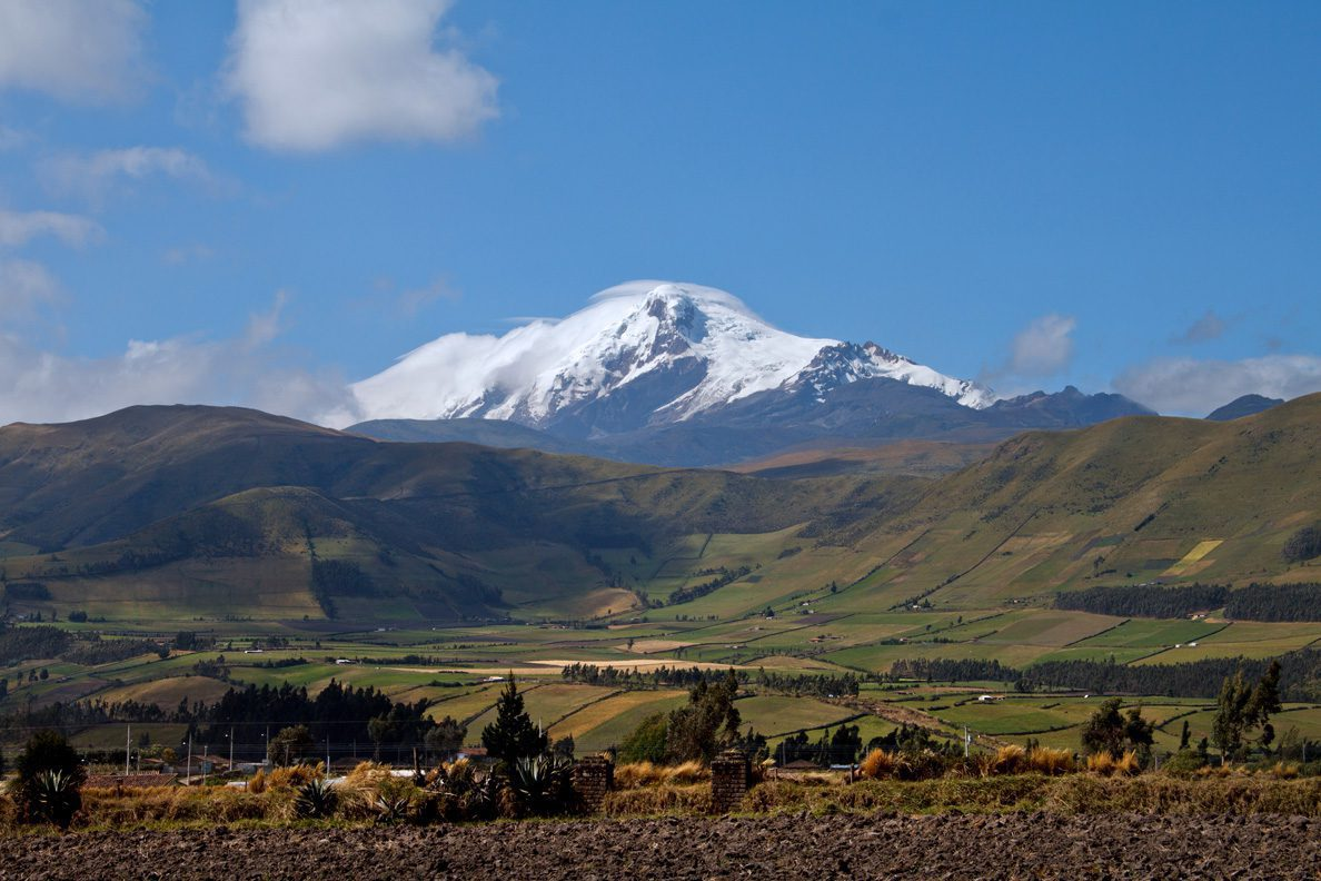 landscape with snowcapped mountain and blue sky on Ecuador tour