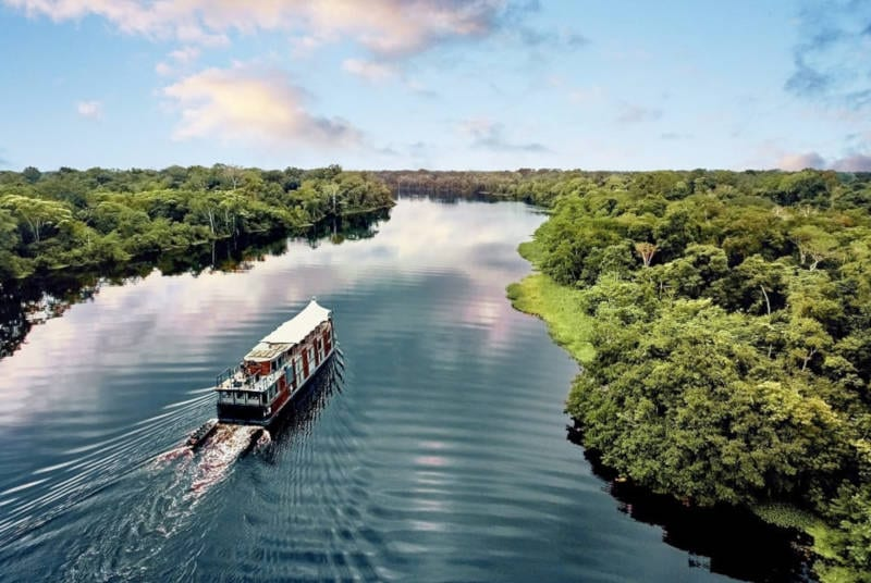 solo travel groups cruise on a boat going down the amazon river