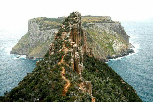 Australia self-drive tour brings you to a rugged walking trail surrounded by ocean in tasmania