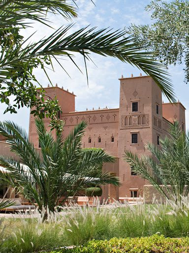 kasbah of dar ahlam seen through the palm fronds across the garden on a North Africa & Middle East safari