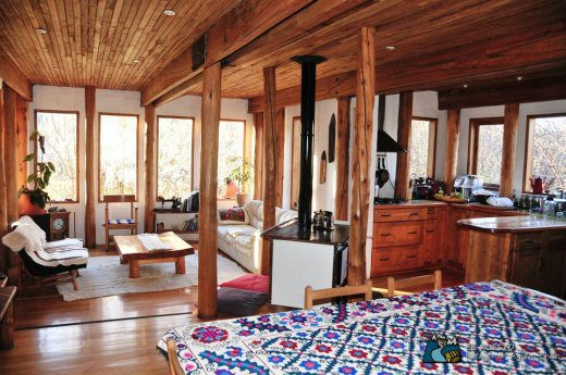cozy lodge interior with wood walls and colorful patterned rug