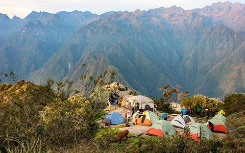 colorful tents in a mountaintop clearing