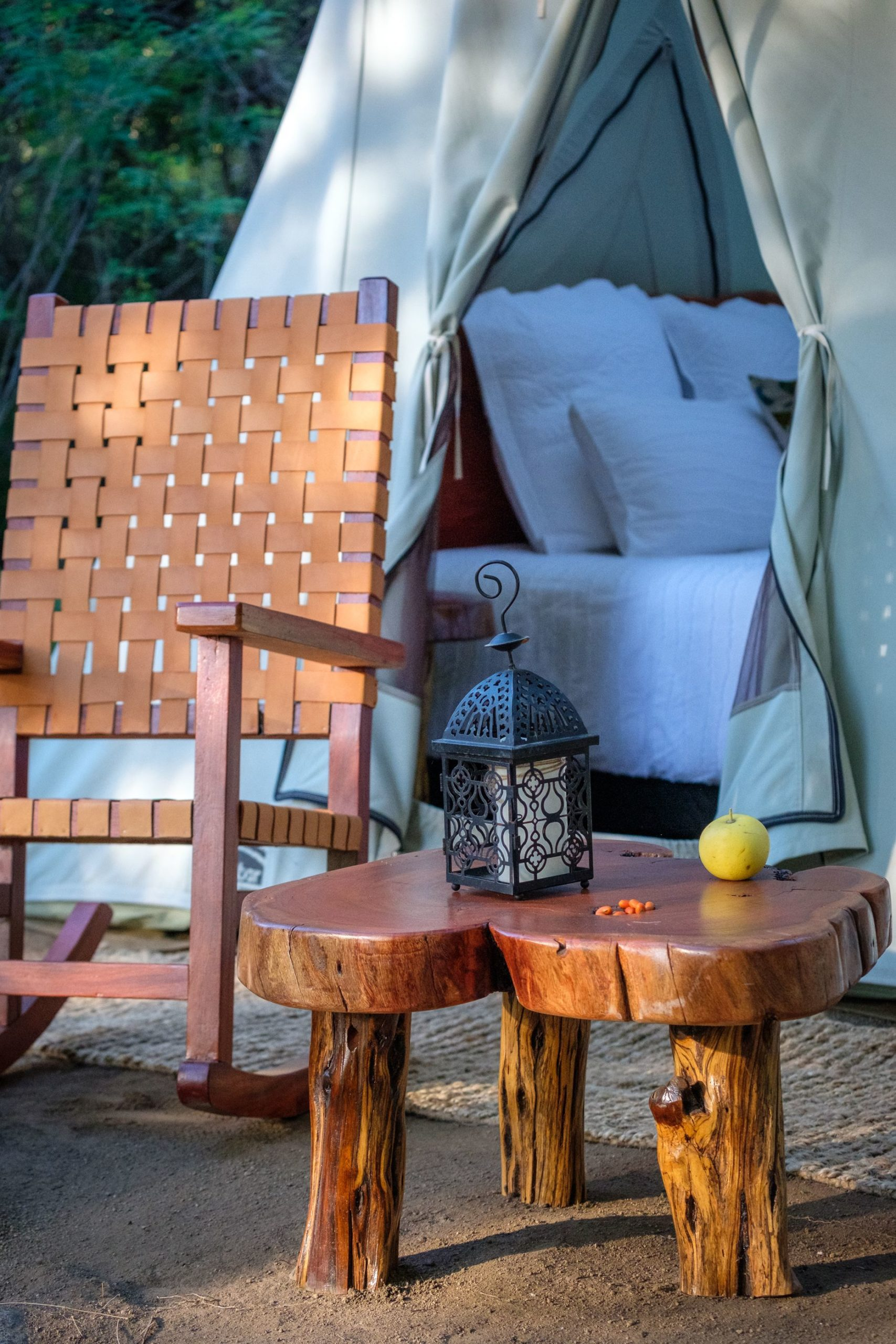 comfortable rocking chair set up outside luxury tent