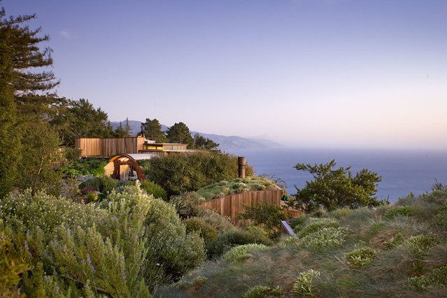 Stunning room with lights on overlooking the pacific ocean at Big Sur