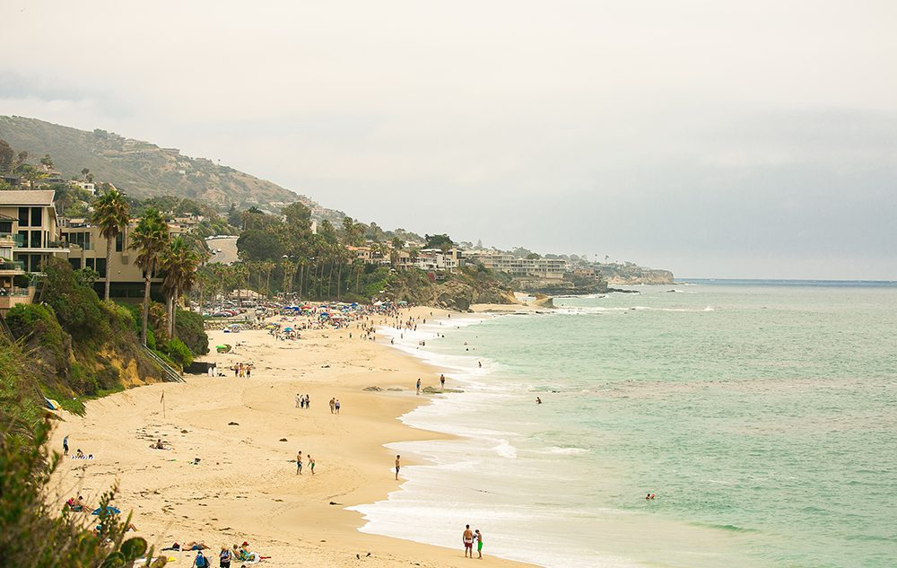 light green water and yellow sand of laguna beach