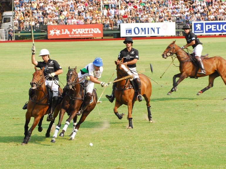 polo players hitting the ball at the Argentine Polo Open