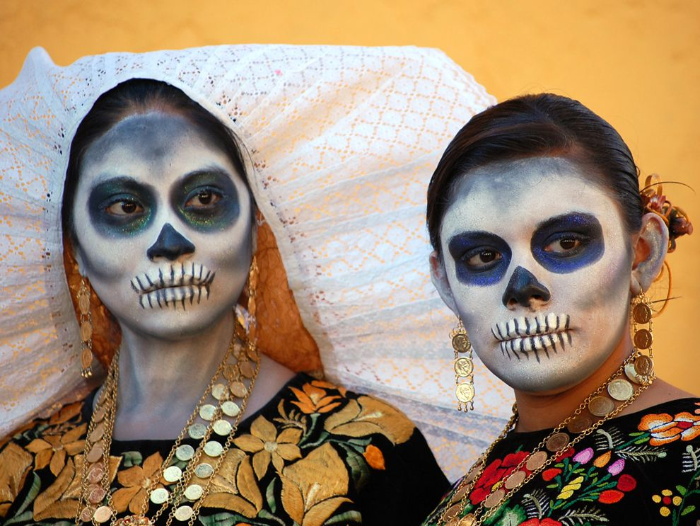 two women dressed in festive garb for Day of the Dead