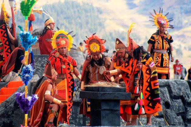 colorful dancers participating in a ritual for Fiesta del Inti Raymi in Peru